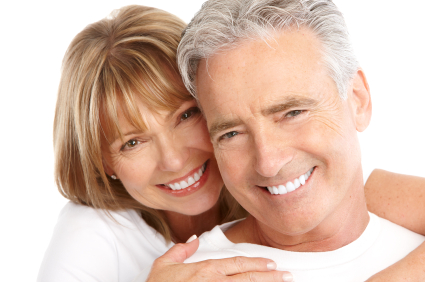 An old couple in love smiling after their Restorative treatment by Mid Valley Dental